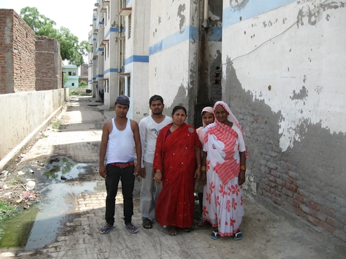 500-Sheela (Centre) with other residents in front of crumbling infrastructure-2