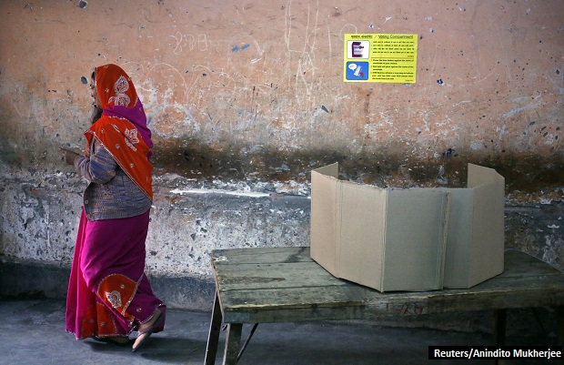 A voter walks away after casting her vote at a polling station during the state assembly election in New Delhi February 7, 2015. REUTERS/Anindito Mukherjee (INDIA - Tags: POLITICS ELECTIONS) - RTR4OLCJ