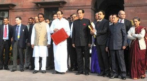 The Union Finance Minister, Shri P. Chidambaram departs from North Block to Parliament House to present the Interim Budget 2014-15, in New Delhi on February 17, 2014	 	The Ministers of State for Finance, Shri Namo Narain Meena and Shri Jesudasu Seelam and other officials of the Ministry are also seen.