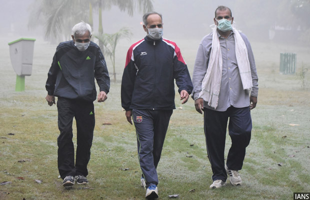 Gurugram: People wear masks to protect themselves as the levels of pollution increased in Gurugram on Nov 8, 2017. (Photo: IANS)
