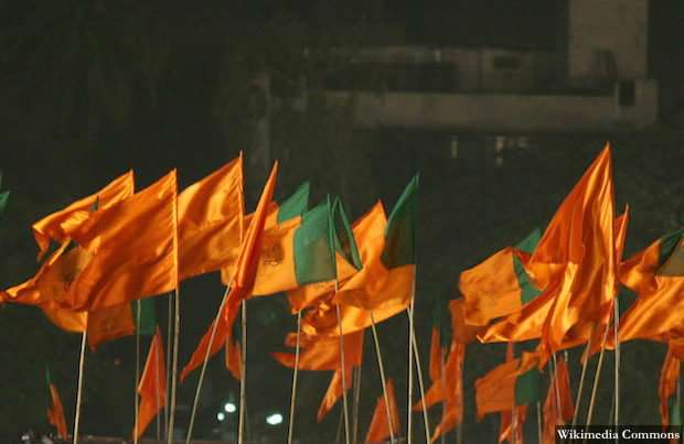 Party flags of Bharatiya Janta Party (BJP) and Shiv Sena are on dispaly during Lal Krishna Advani,NDA's Prime ministrial candidate address during an election rally in the western indian city of Mumbai on 6th March,2008