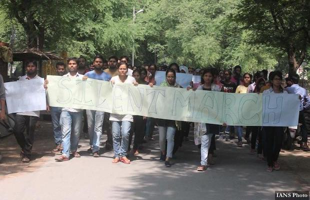 Varanasi: Students of Banaras Hindu University (BHU) carry out a silent protest against the molestation of a student in the campus in Varanasi on Sept 24, 2017. (Photo: IANS)