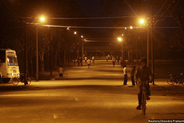 People walk through a road illuminated by street lights in Allahabad Uttar Pradesh. The governmentu0027s Street Lighting National Programme aims to replace 35 ... & If National Streetlight Plan Works India Will Save Rs 5000 Cr ...