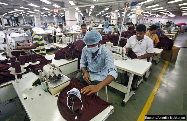 Employees work inside a garment factory of Orient Craft Ltd in Gurgaon